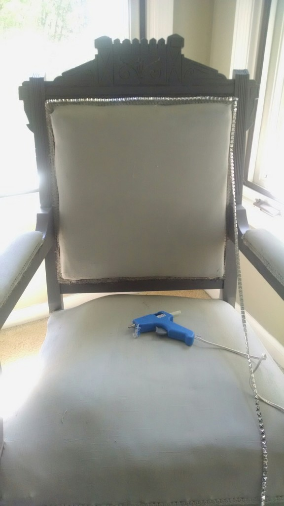 stud trim on arm chair
