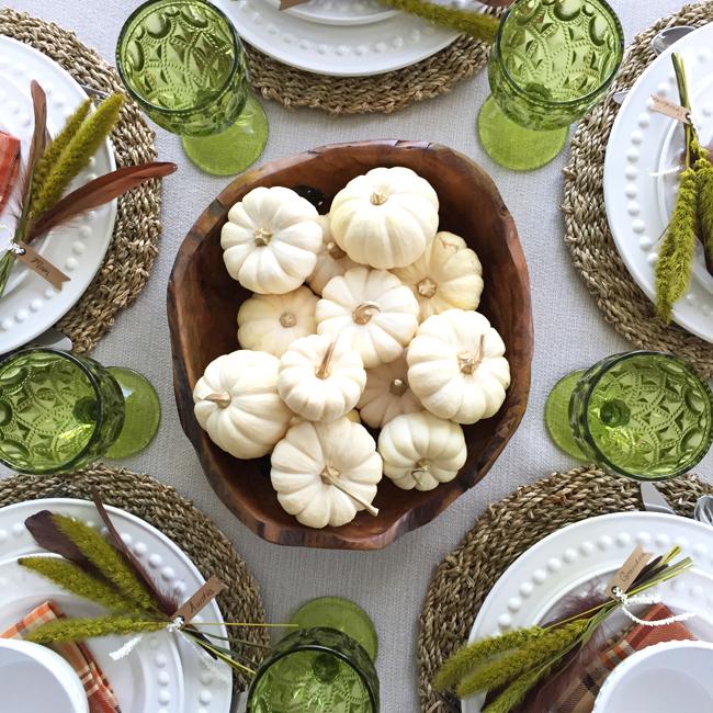 thanksgiving tablescape white pumpkins green glasses