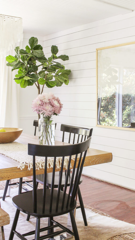 modern farmhouse dining room with windsor chairs and abstract art