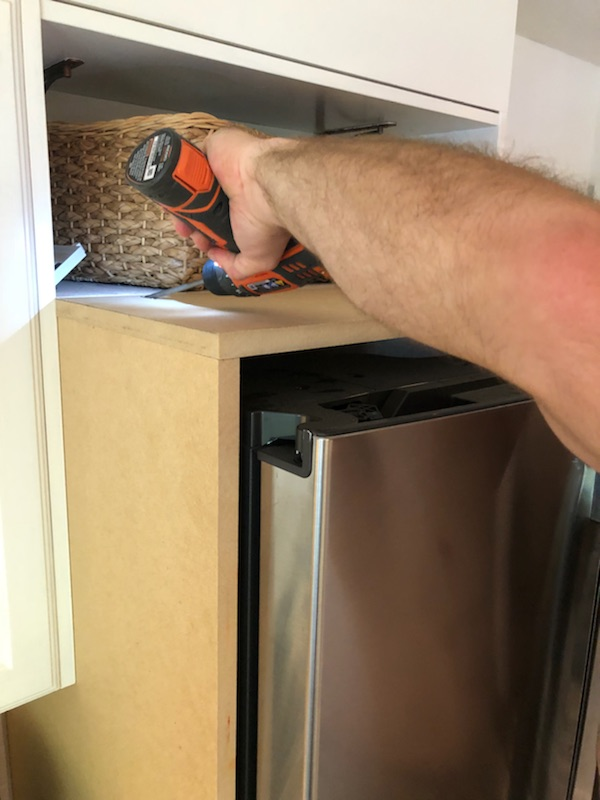 DIY refrigerator framing with cabinetry