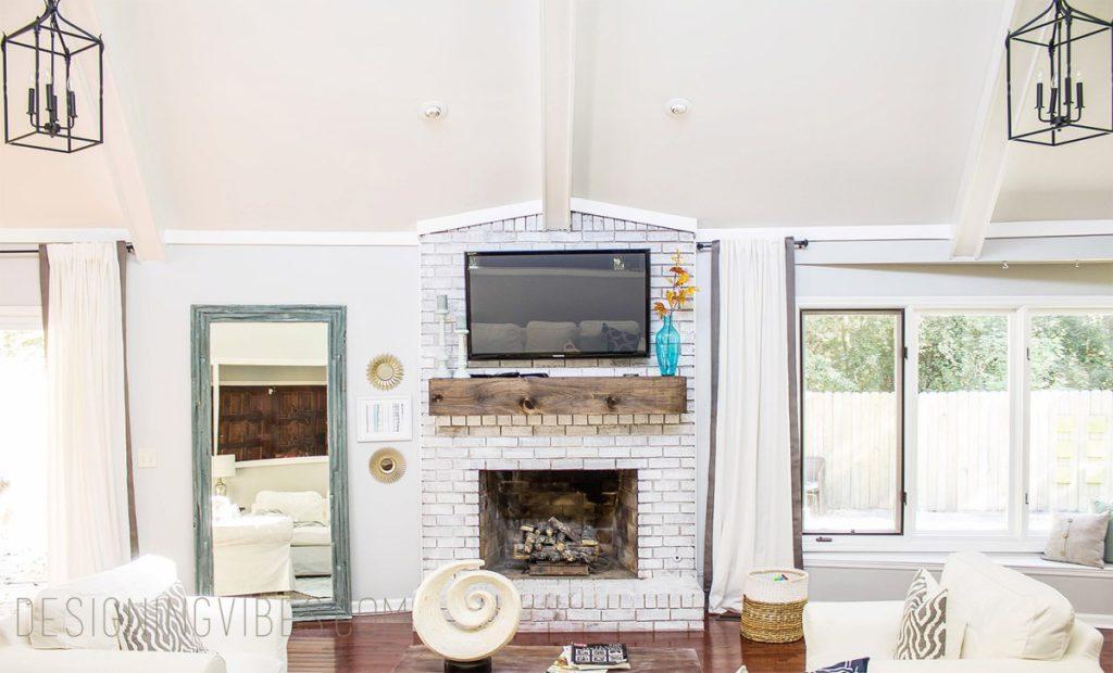 whitewashing over brick fireplace with paint