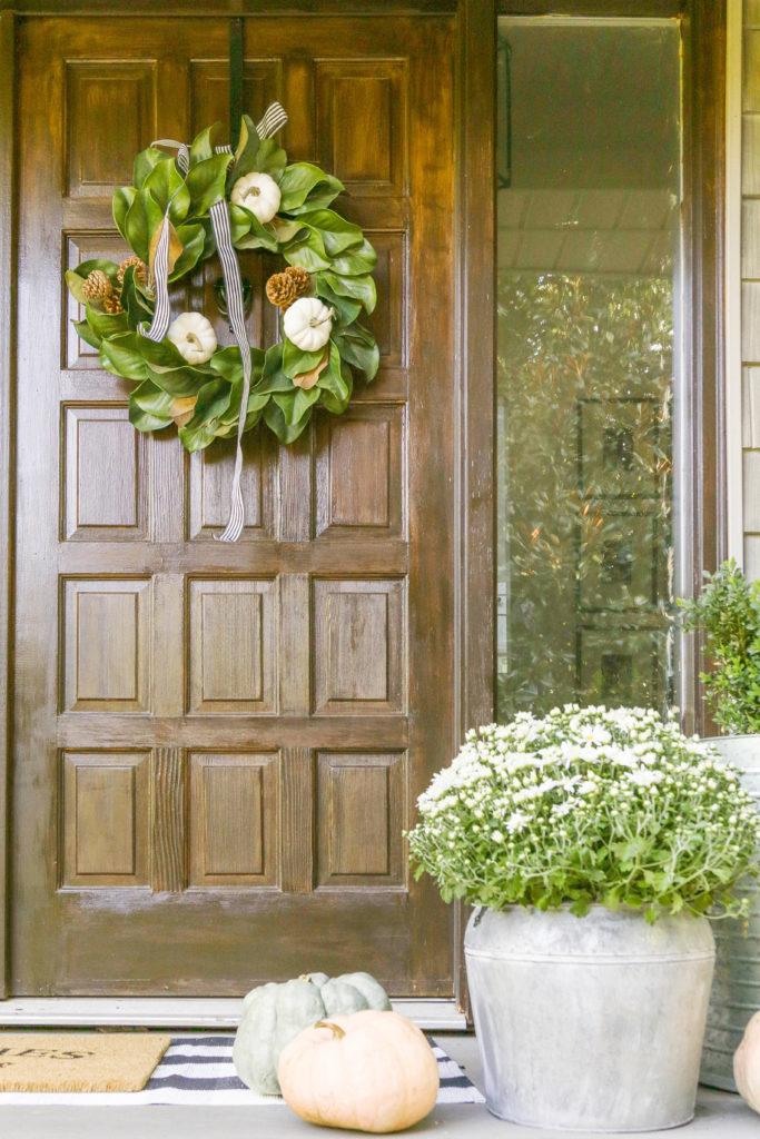 DIY neutral fall wreath with white pumpkins