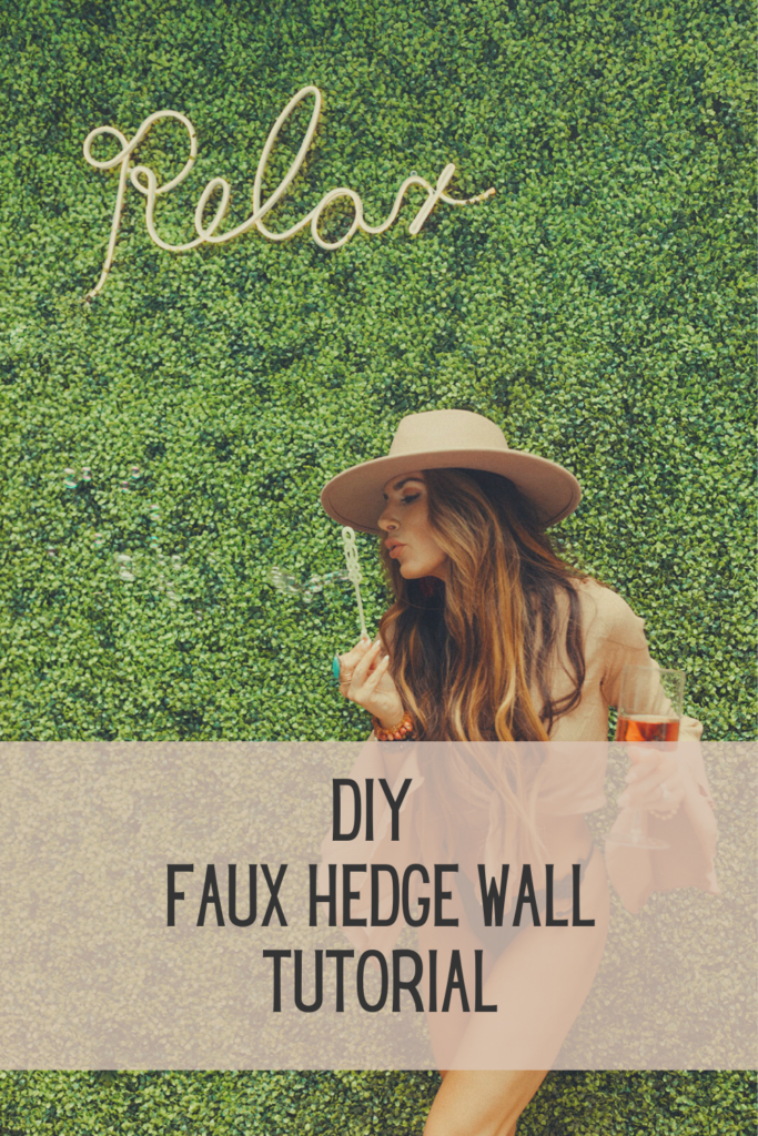 diy photo wall backdrop made out of faux greenery