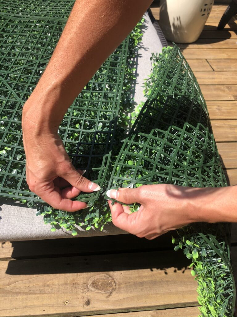 diy selfie hedge wall with faux boxwood tiles